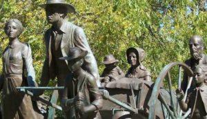 pionniers avec une charrette à bras
