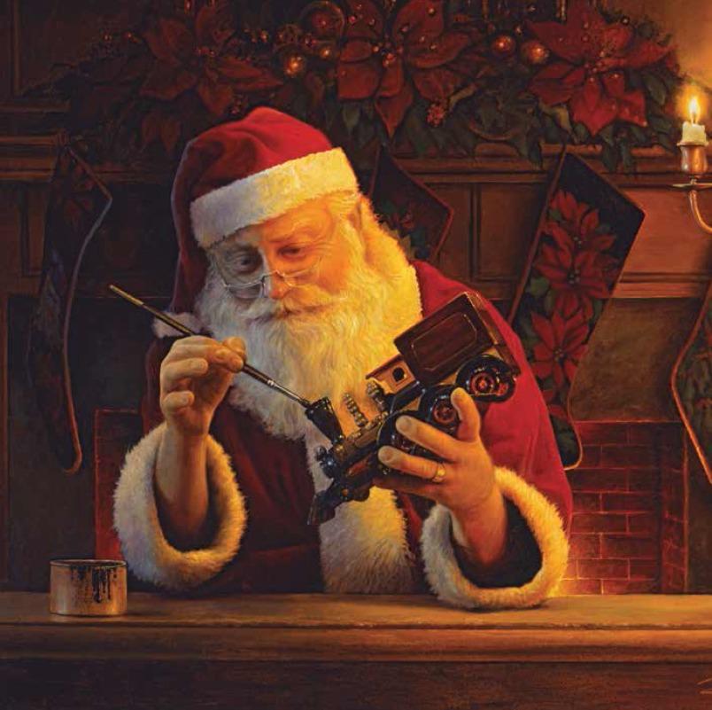 Père Noël faisant un jouet